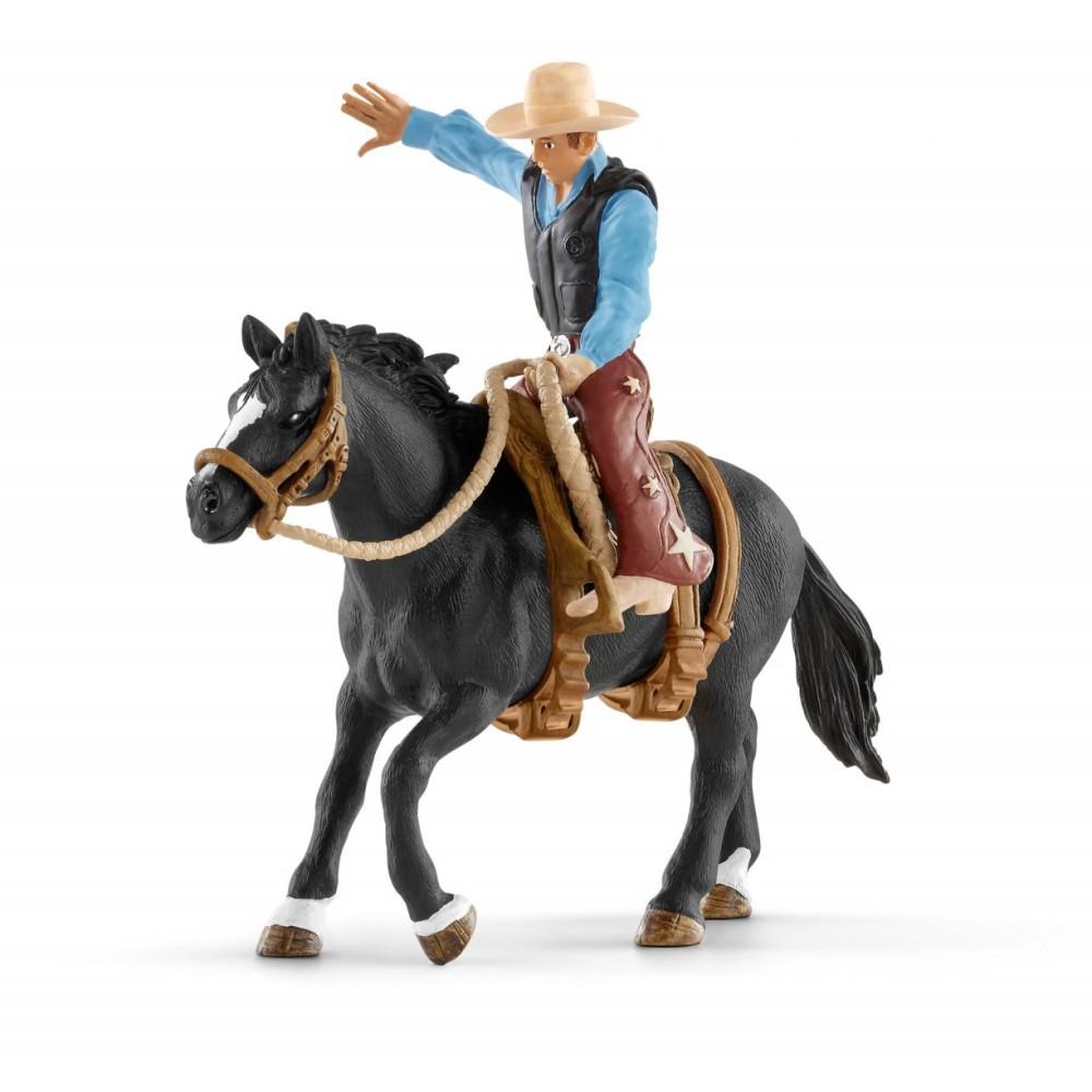 Schleich - Kowboy ujeżdżający dzikiego konia 41416